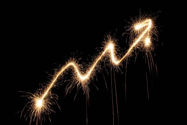 graph arrow sparkler stock photo