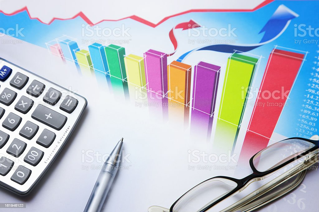 graph, calculator, pen, glasses royalty-free stock photo