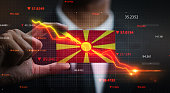 Graph Falling Down in Front Of Republic of Macedonia Flag. Crisis Concept