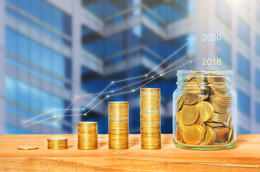 istock graph growth up stat plan on coin stack on wood table with plant growing against building background. investment. startup. financial. saving concept for business success. wealth budgeting funding. 1195397068