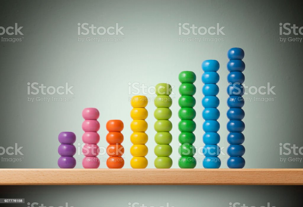 Graph made of colored beads of abacus stock photo