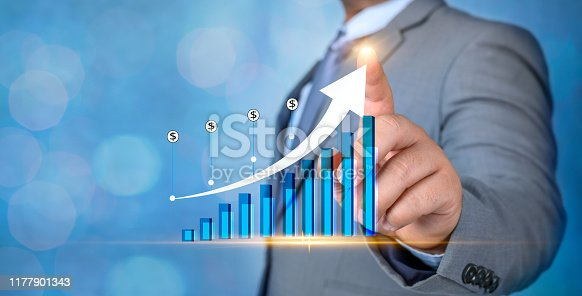 istock Graph of financial growth global communications Binary Smart Phones and world Internet Businesspeople press the phone to communicate in the Internet Stock chart Researching process.business Team Working Startup modern office Laptop global strategy virtual 1177901343