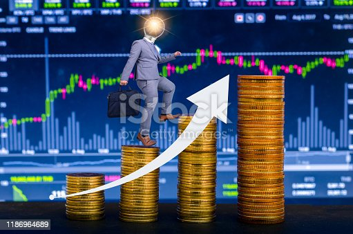 655652514istockphoto Graph of financial growth global communications Binary Smart Phones and world Internet Businesspeople press the phone to communicate in the Internet Stock chart Researching process.business Team Working Startup modern office Laptop global strategy virtual 1186964689