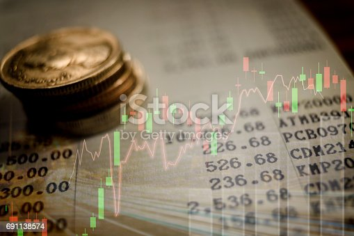 864278180istockphoto graph on rows of coins for finance and banking concept 691138574