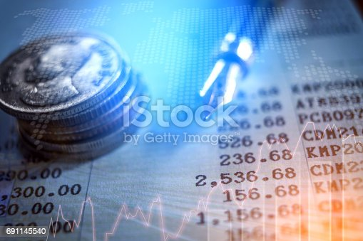 864278180istockphoto graph on rows of coins for finance and banking concept 691145540