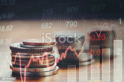 istock Graph on rows of coins for finance and banking concept 697544392