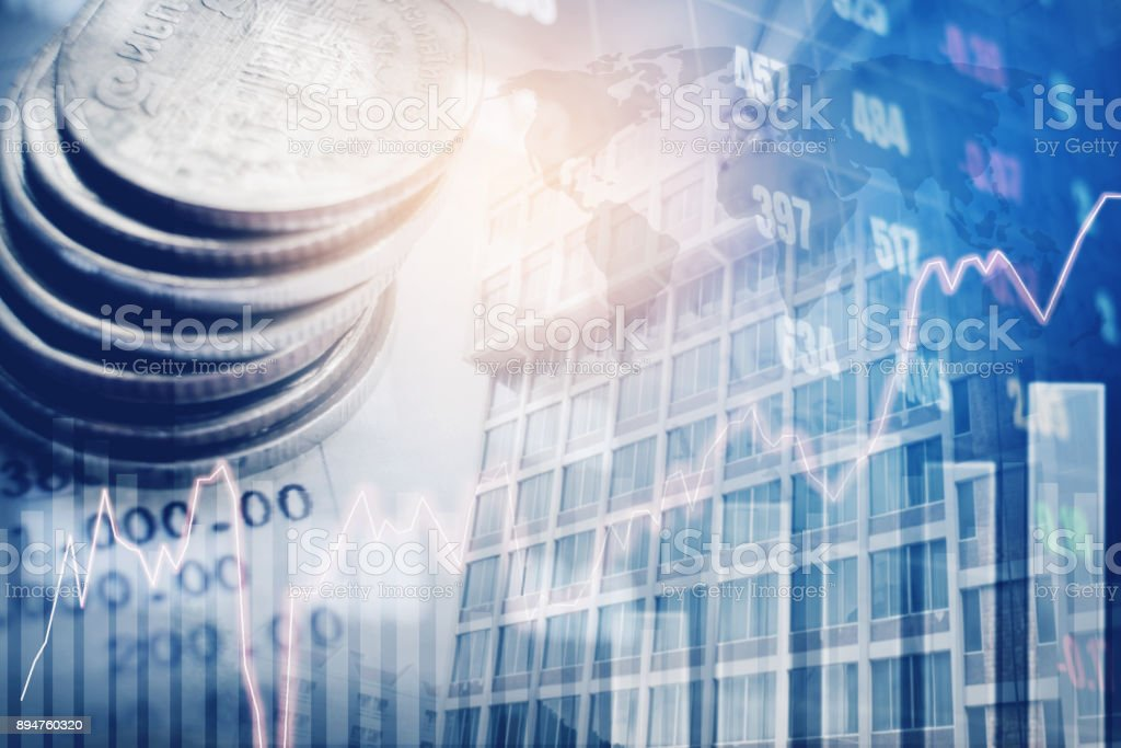 Graph on rows of coins for finance and banking on digital stock market financial exchange and Trading graph Double exposure city on the background stock photo