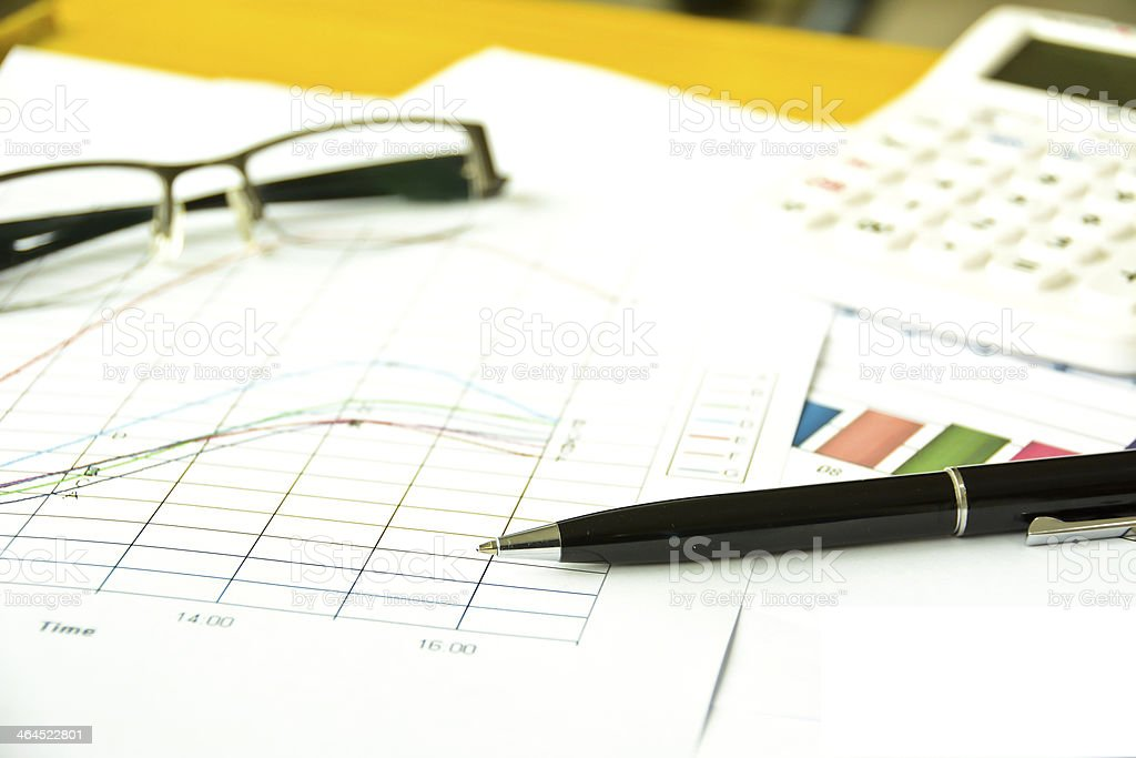 graph with pen, glasses and calculator royalty-free stock photo