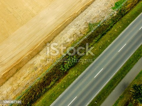 1095367134 istock photo Graphic and abstract aerial view of the vertical photograph of a road with markings between fields. 1095367144