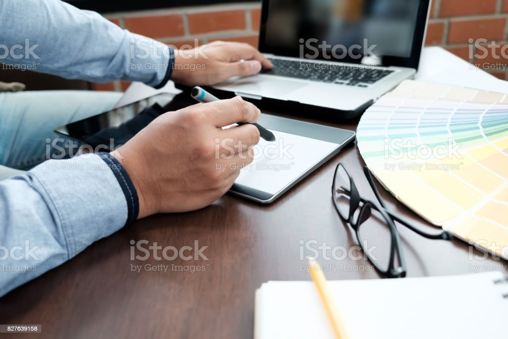 Graphic design and color swatches and pens on a desk. Architectural drawing with work tools and accessories. stock photo