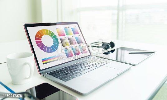 Graphic design concept. Laptop computer in office. Color management.