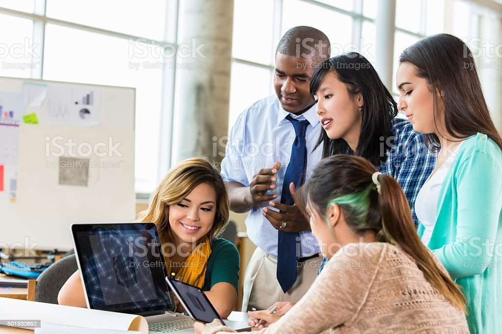 Graphic design team brainstorming ideas in modern office stock photo