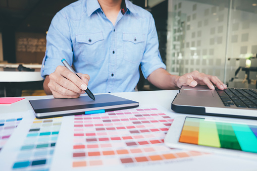 istock Graphic designer and color swatches and pens on a desk. 918459658