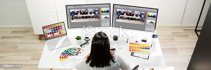 Graphic Designer Artist Working On Multiple Computer Screens