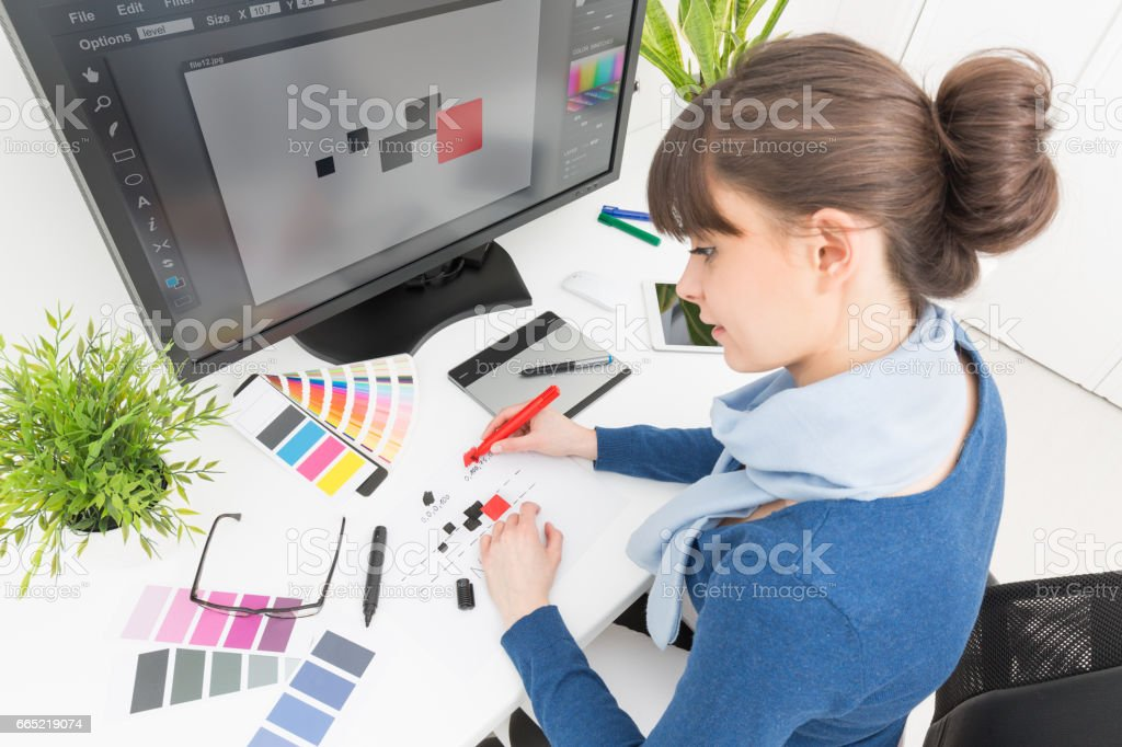 Graphic designer at work. Color samples. NOTE TO INSPECTOR: I am the author of everything that you see in the image (interface program on the screen - property release added). stock photo