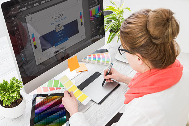 Graphic designer at work. Color samples. stock photo