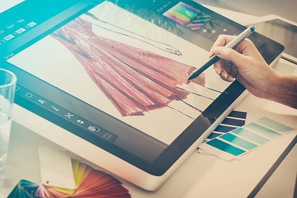 Graphic designer at work. Color samples. fashion fashionable designer clothing clothes cloth sketch design designing drawing draw stylist woman female red concept - stock image fashion designer stock pictures, royalty-free photos & images