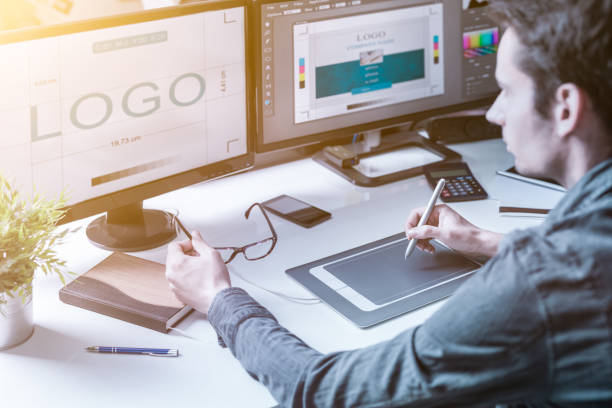 graphic designer at work. color samples. - logo design stock photos and pictures