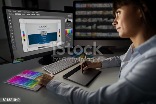 istock Graphic designer at work. Color samples. 821821942