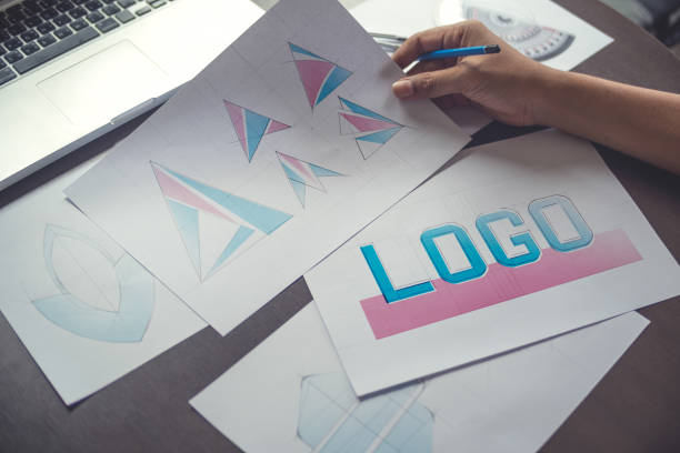 Graphic designer creative design sketch drawing logo Trademark brand Workspace stock photo
