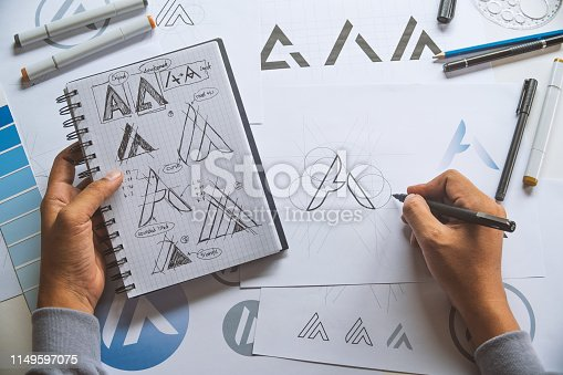 istock Graphic designer development process drawing sketch design creative Ideas draft Logo product trademark label brand artwork. Graphic designer studio Concept. 1149597075