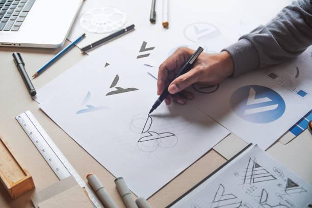 graphic designer development process drawing sketch design creative ideas draft logo product trademark label brand artwork. graphic designer studio concept. - grafica computerizzata foto e immagini stock