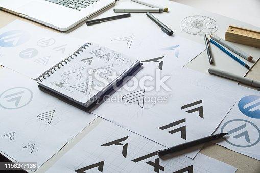 istock Graphic designer development process drawing sketch design creative Ideas draft Logo product trademark label brand artwork. Graphic designer studio Concept. 1156277138