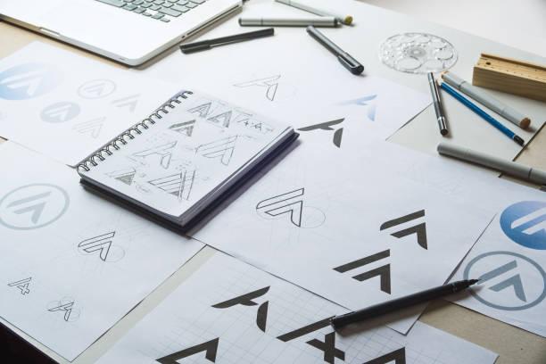 graphic designer development process drawing sketch design creative ideas draft logo product trademark label brand artwork. graphic designer studio concept. - logo imagens e fotografias de stock