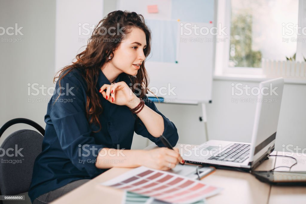 Graphic designer drawing on digital tablet stock photo