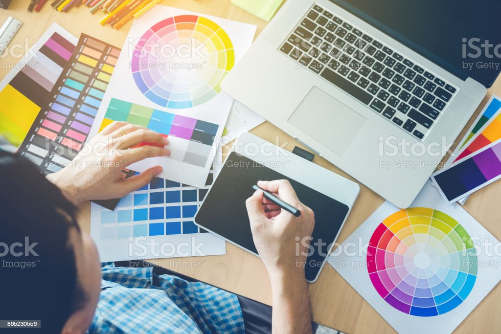Graphic designer drawing on graphics tablet at workplace stock photo