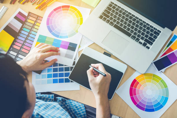 Graphic designer drawing on graphics tablet at workplace Graphic designer drawing on graphics tablet at workplace design professional stock pictures, royalty-free photos & images