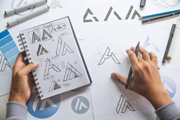 graphic designer drawing sketch design creative ideas draft logo product trademark label brand artwork. graphic designer studio concept. - logo imagens e fotografias de stock
