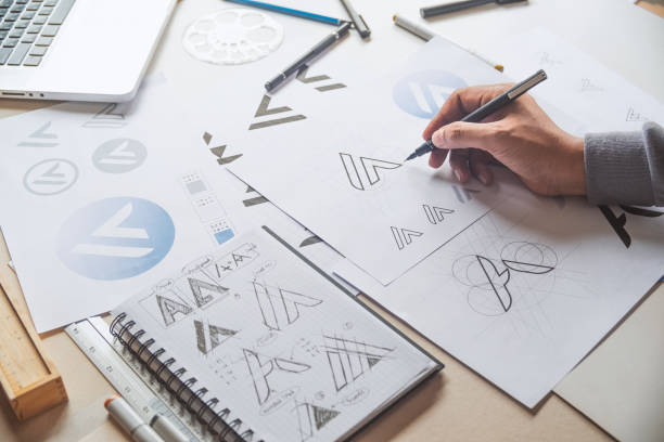 graphic designer drawing sketch design creative ideas draft logo product trademark label brand artwork. graphic designer studio concept. - badge logo stock pictures, royalty-free photos & images