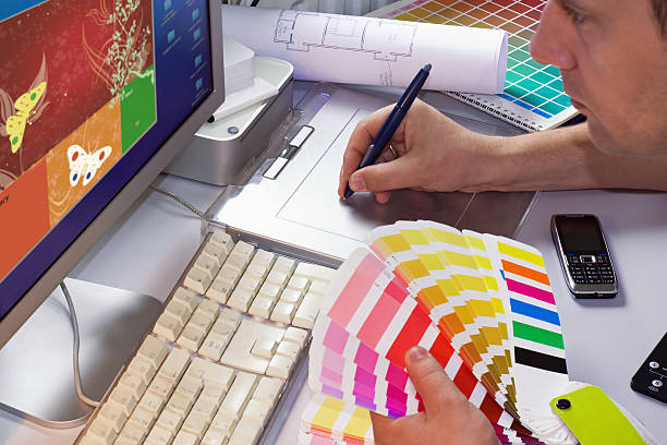Graphic designer selects colors to project stock photo