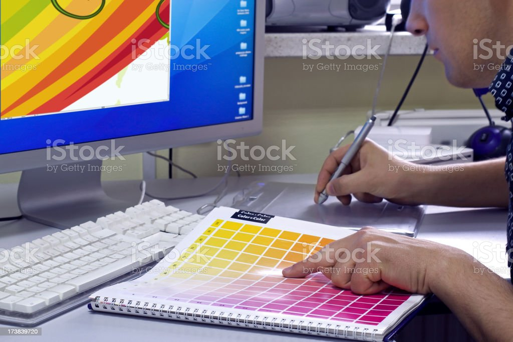 Graphic designer selects the color of the color swatch royalty-free stock photo