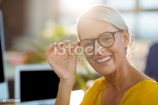 919520858 istock photo Graphic designer sitting in office 651970466