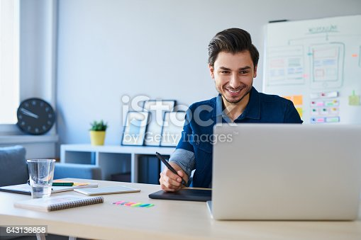 istock Graphic designer sketching project on graphic tablet 643136658