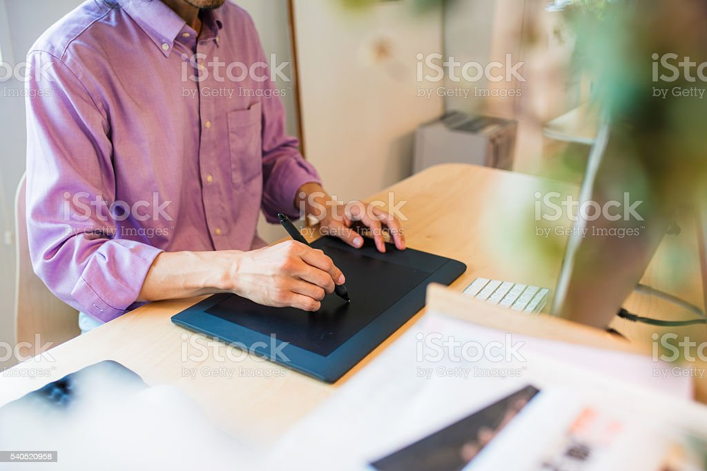 Graphic designer using a digital tablet stock photo