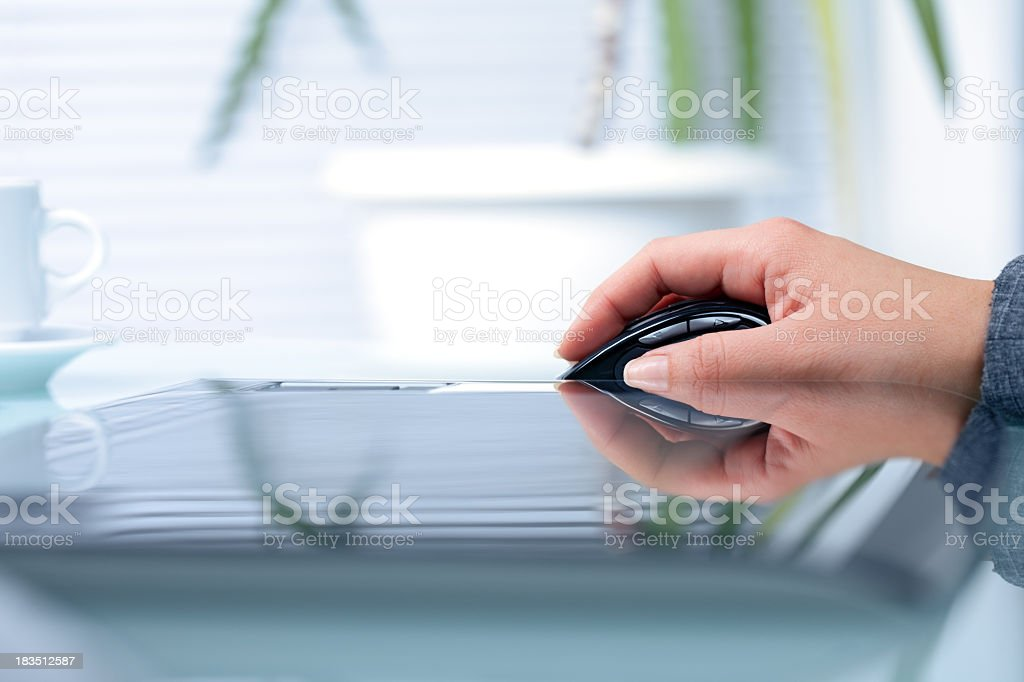 Graphic designer using computer mouse in the office royalty-free stock photo