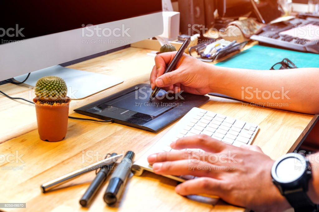 Graphic designer using digital tablet and computer Sketch work in Home stock photo