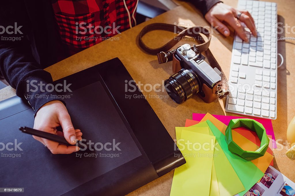 Graphic designer using graphics tablet stock photo