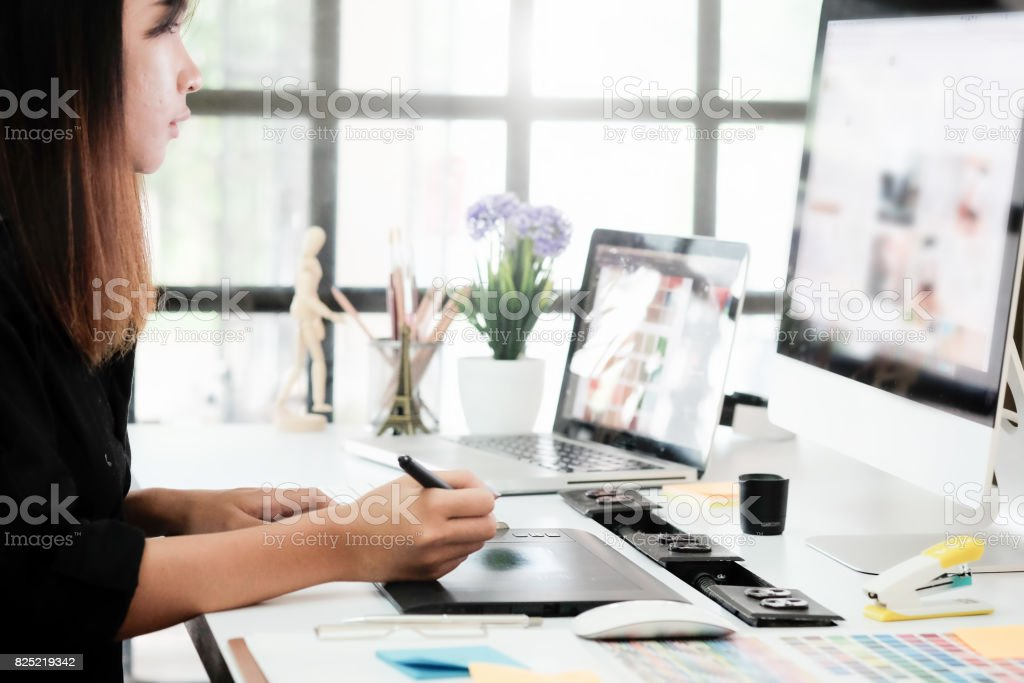 Graphic designer woman working on creative office with create graphic on computer. stock photo