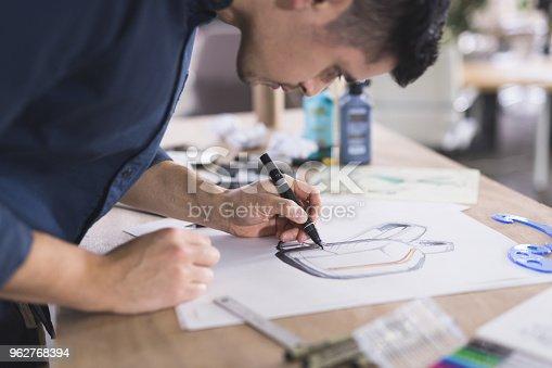 istock Graphic designer working in modern studio space 962768394