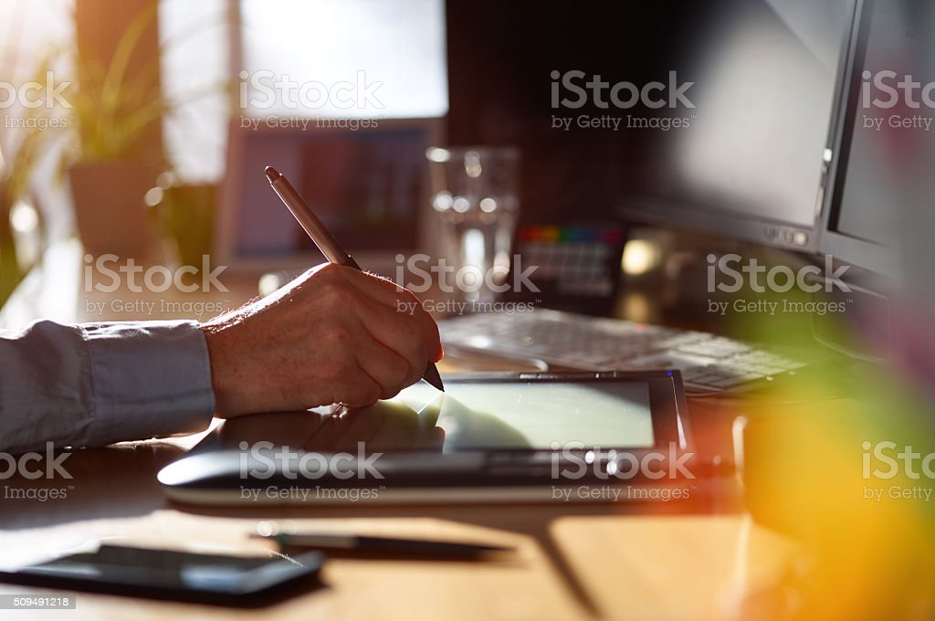Graphic Designer working with digital Drawing tablet and Pen stock photo