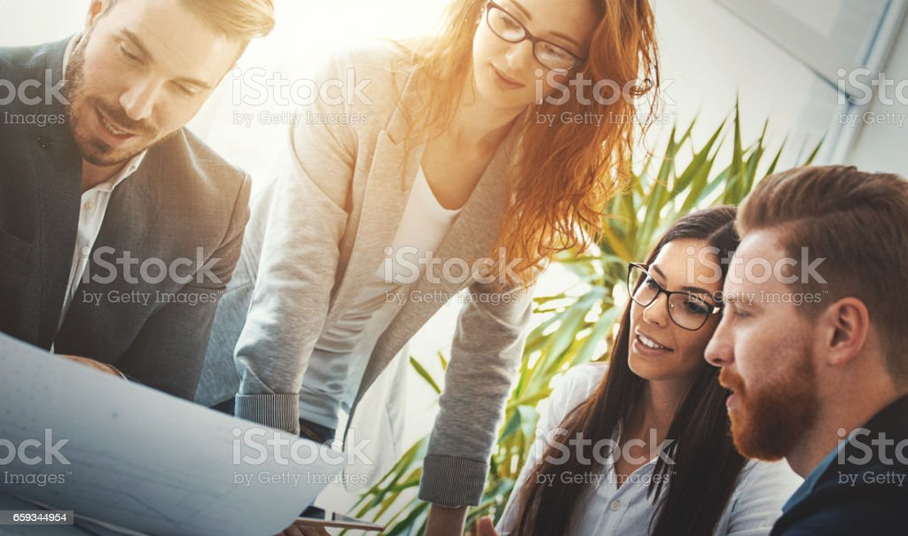 Graphic designers at their studio. stock photo