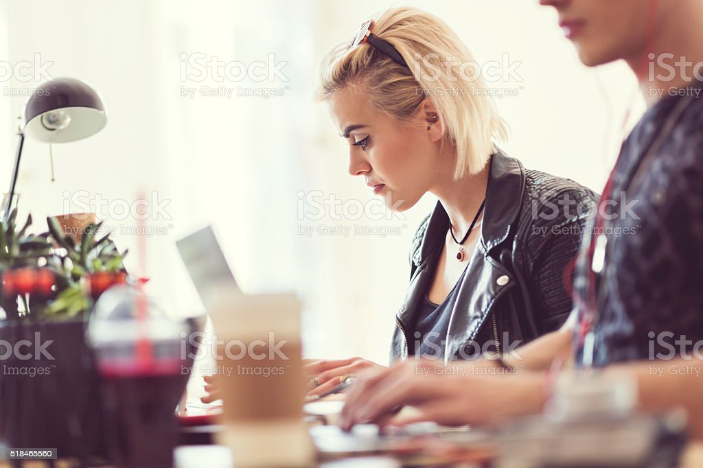 Graphic designers at work, focus on blonde woman royalty-free stock photo