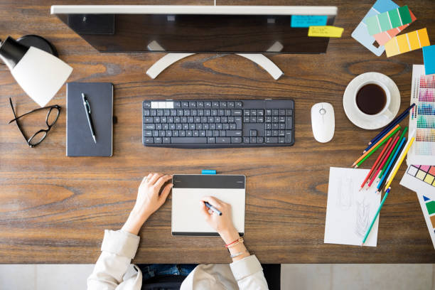 Graphic designers desk stock photo