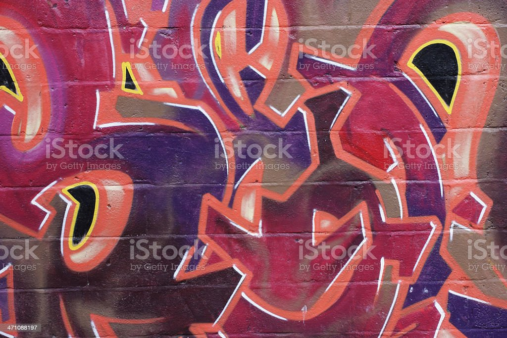 Wall graffiti detail red lettering colourful fiery stock photo