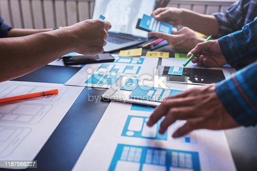Graphic mobile user experience design teamwork help to design new job in modern office. Design Workstyle Freelance Teamwork Concept.