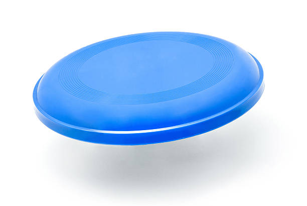 3D graphic of blue frisbee isolated on white background frisbee disc on white background plastic disc stock pictures, royalty-free photos & images